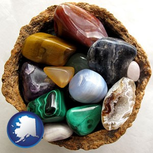 an assortment of polished gemstones - with Alaska icon