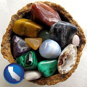 an assortment of polished gemstones - with California icon