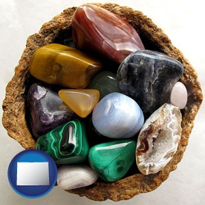 an assortment of polished gemstones - with Colorado icon