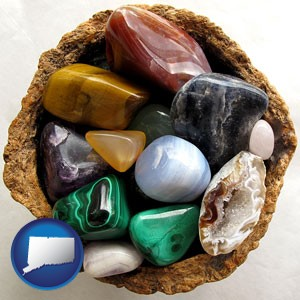 an assortment of polished gemstones - with Connecticut icon