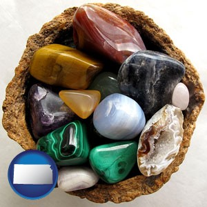 an assortment of polished gemstones - with Kansas icon