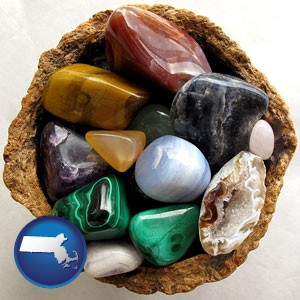 an assortment of polished gemstones - with Massachusetts icon