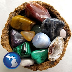 an assortment of polished gemstones - with Michigan icon