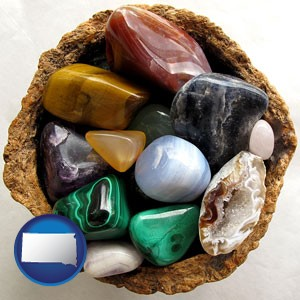 an assortment of polished gemstones - with South Dakota icon
