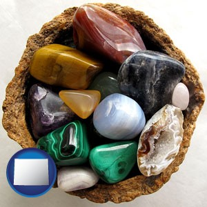 an assortment of polished gemstones - with Wyoming icon